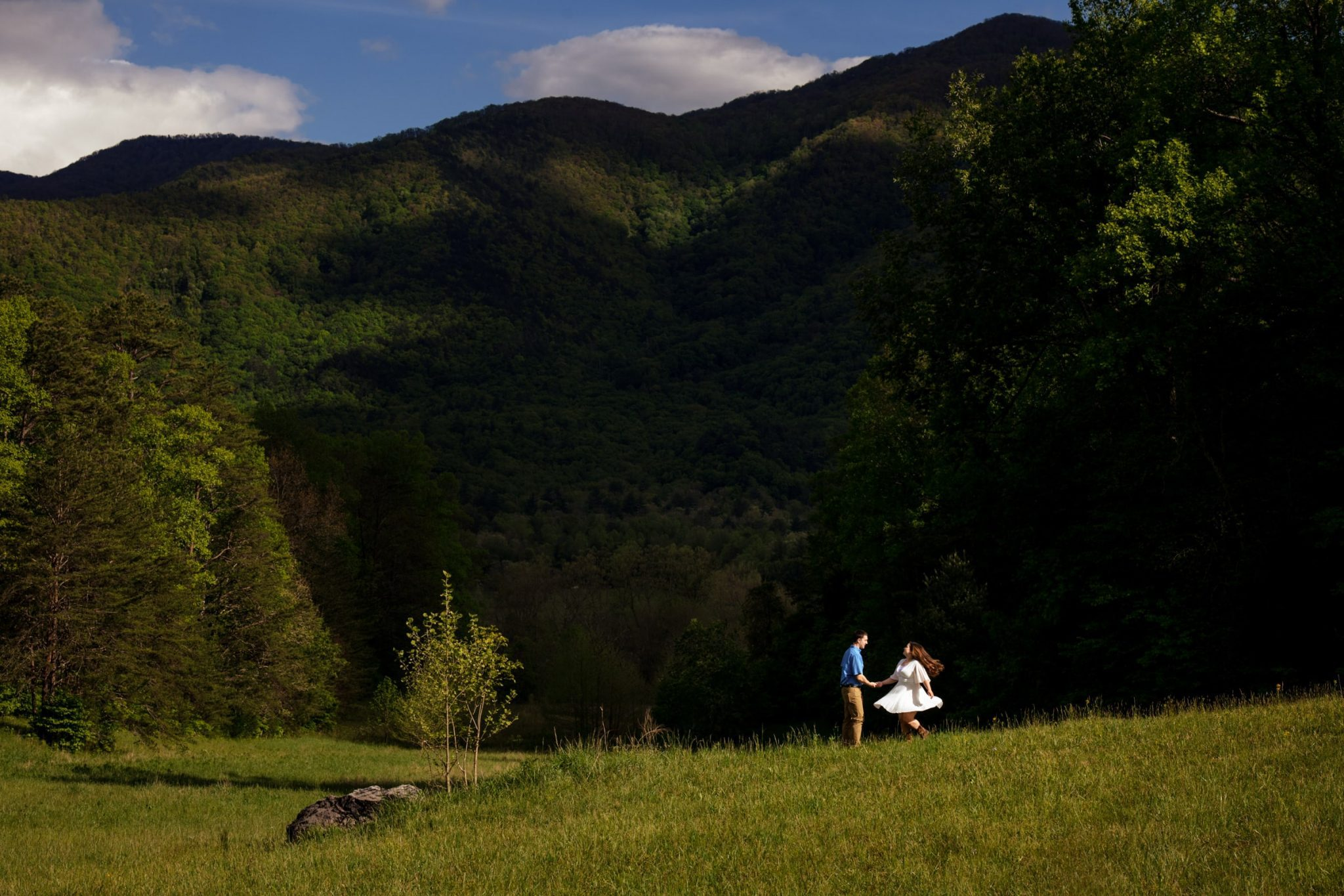 Couple walking during an engagement photoshoot in cades cove national park