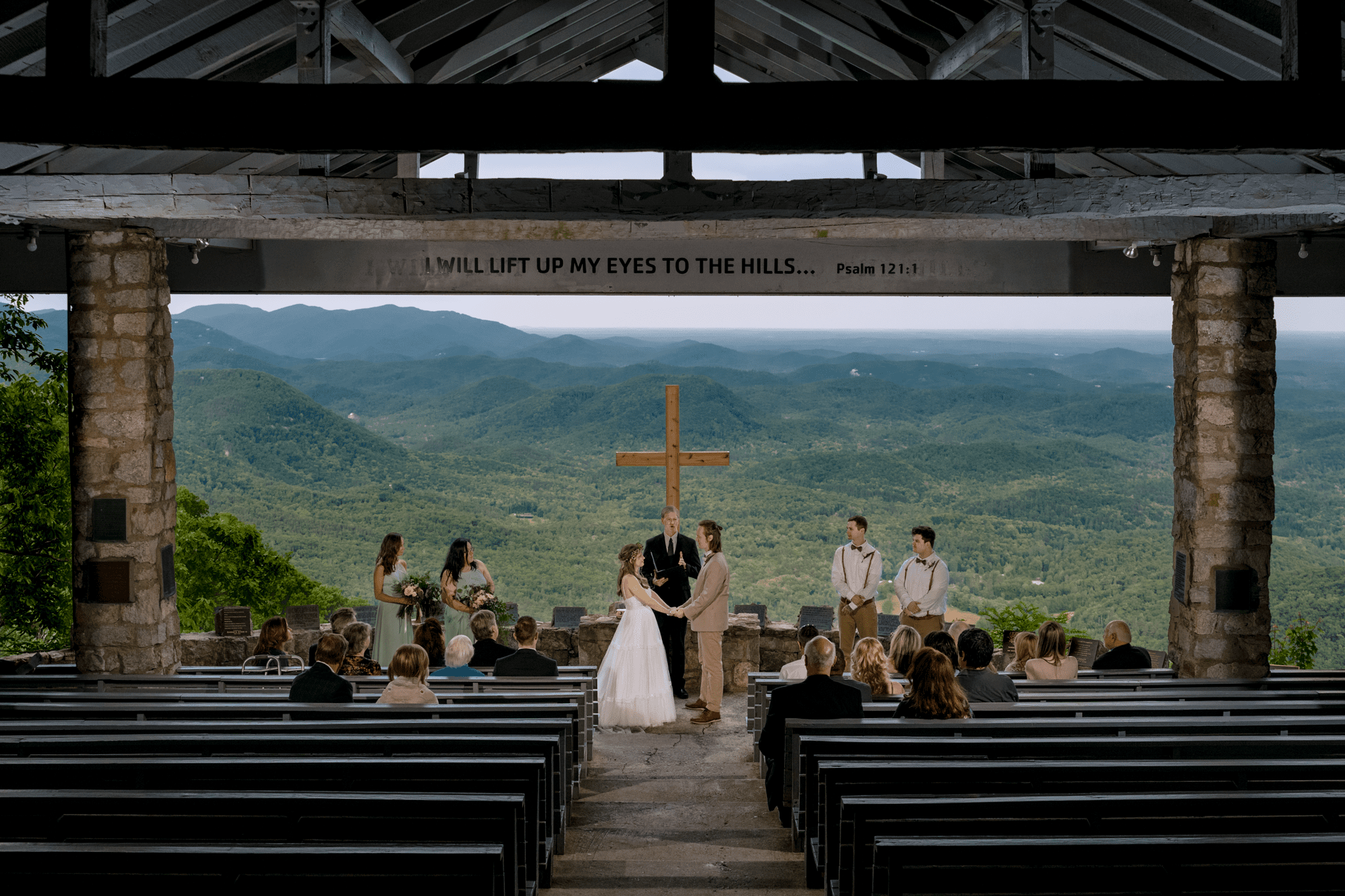 couple standing at the alter at pretty place ymca camp Greenville