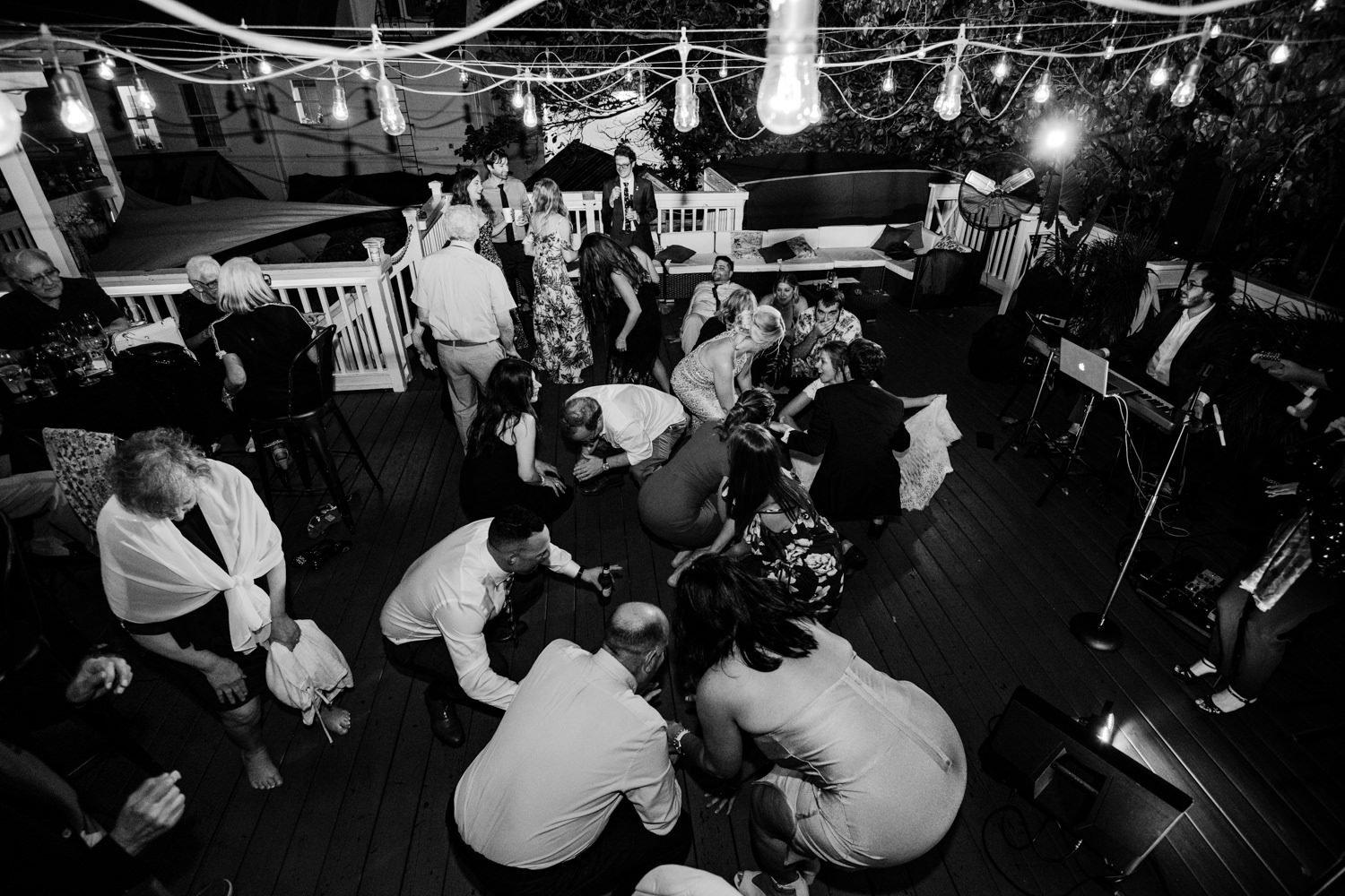 Everyone dancing at a wedding reception at at bagatelle in key west