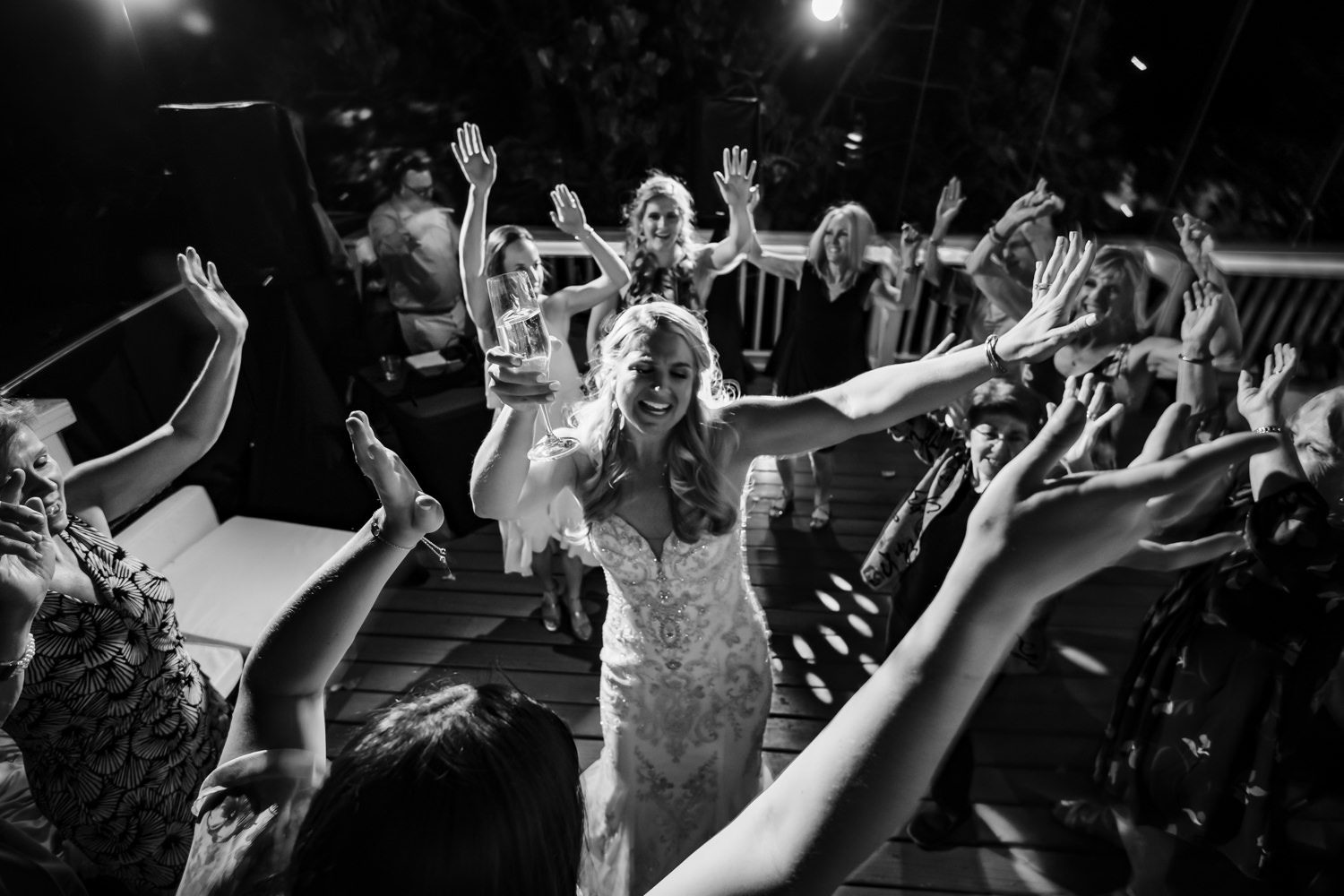 Black and white photo of bride dancing at her wedding reception