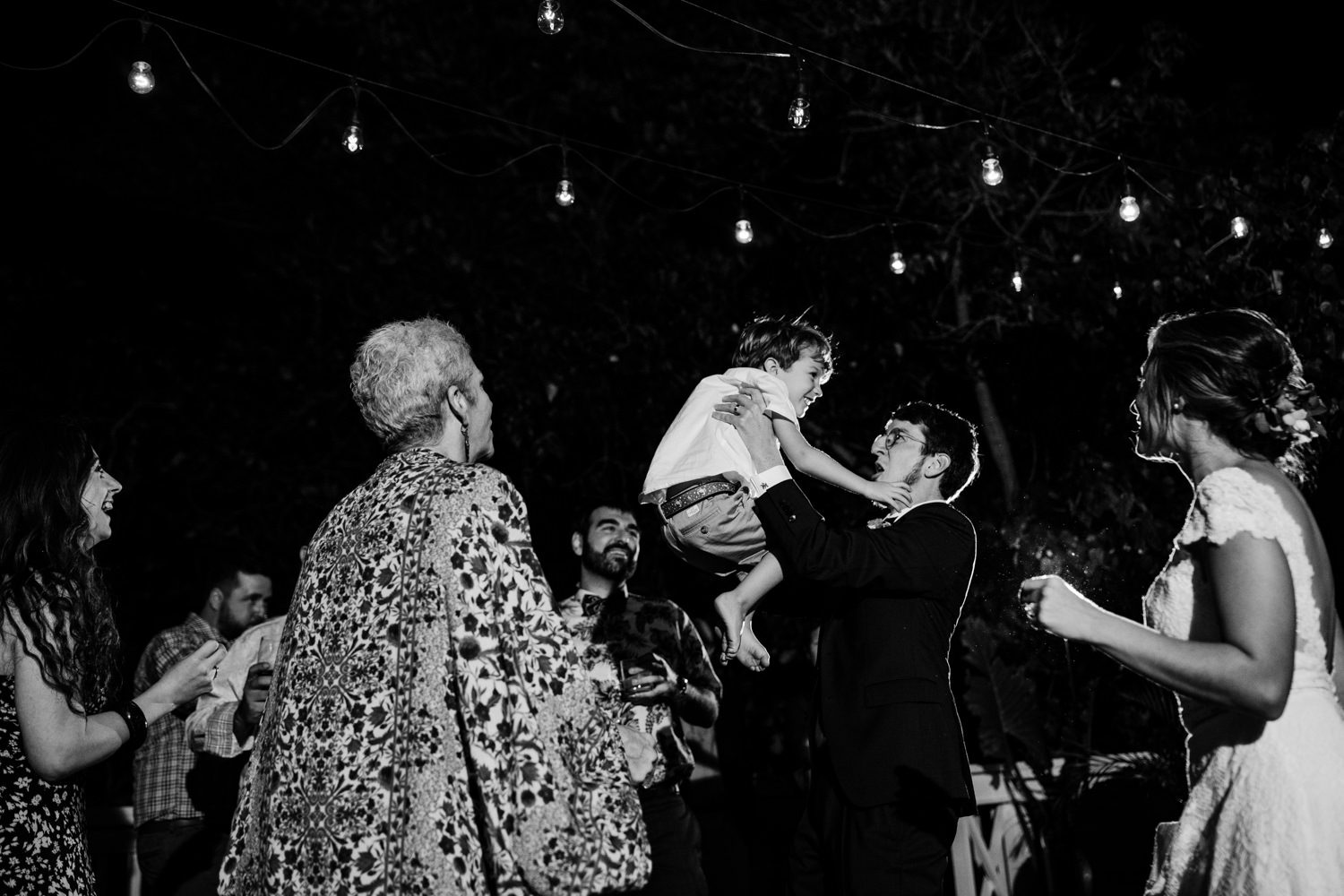 Groom holding up his child while dancing at bagatelle in key west
