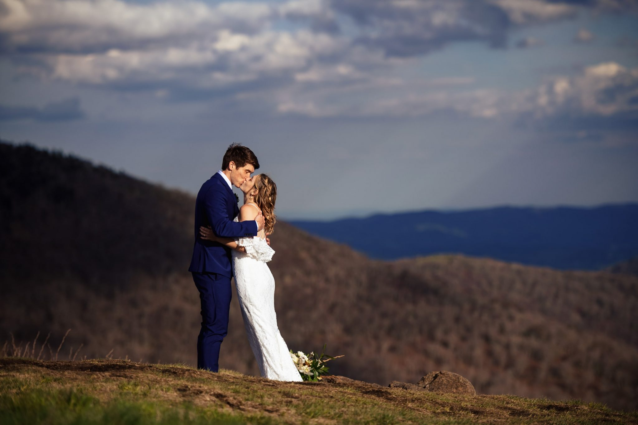 Couple kissing as they elope at carves gat