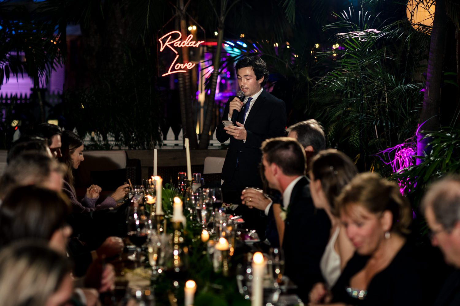 Groom giving a speech at a wedding reception at first flight in key west