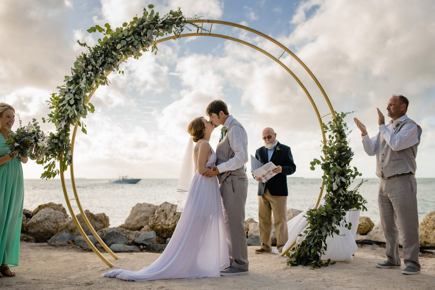 Husband and wife kissing after beach ceremony at fort zachary taylor