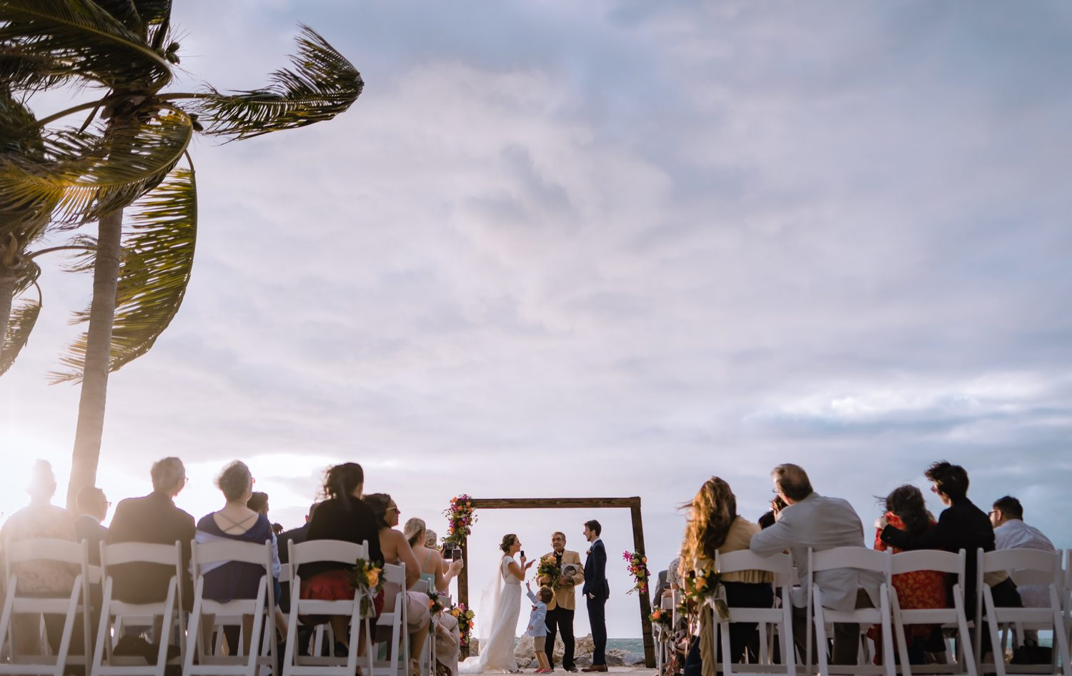Bride and groom at beach wedding ceremony at fort zachary taylor
