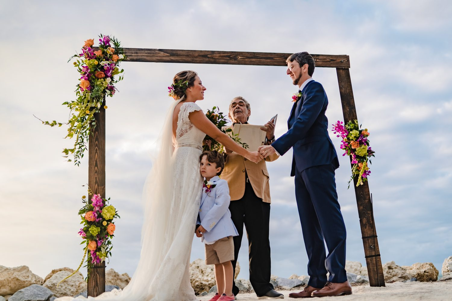 Bride and groom holding hands during wedding ceremony at fort zachary taylor