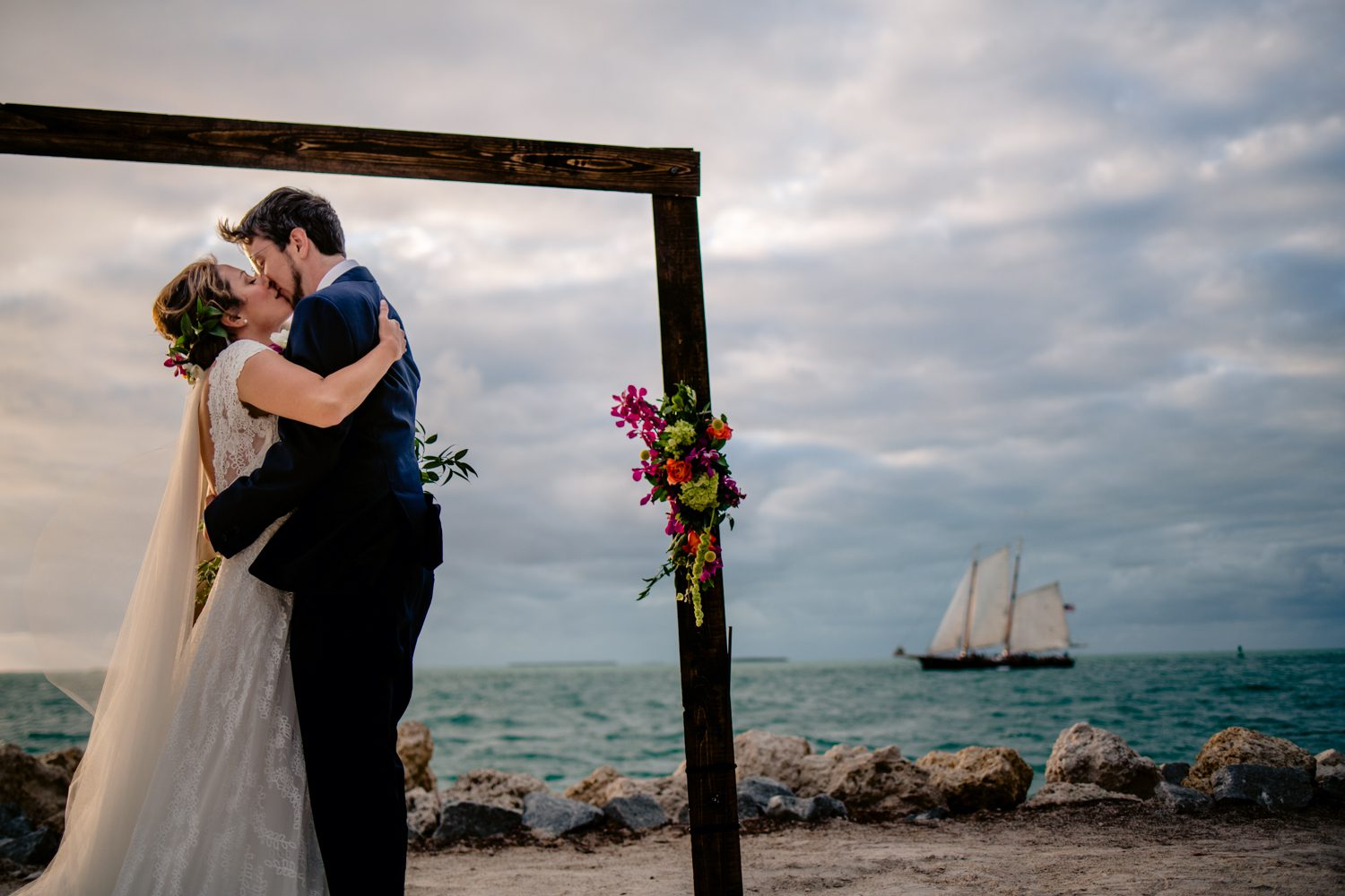Bride and groom kissing after saying vows at fort zachary taylor