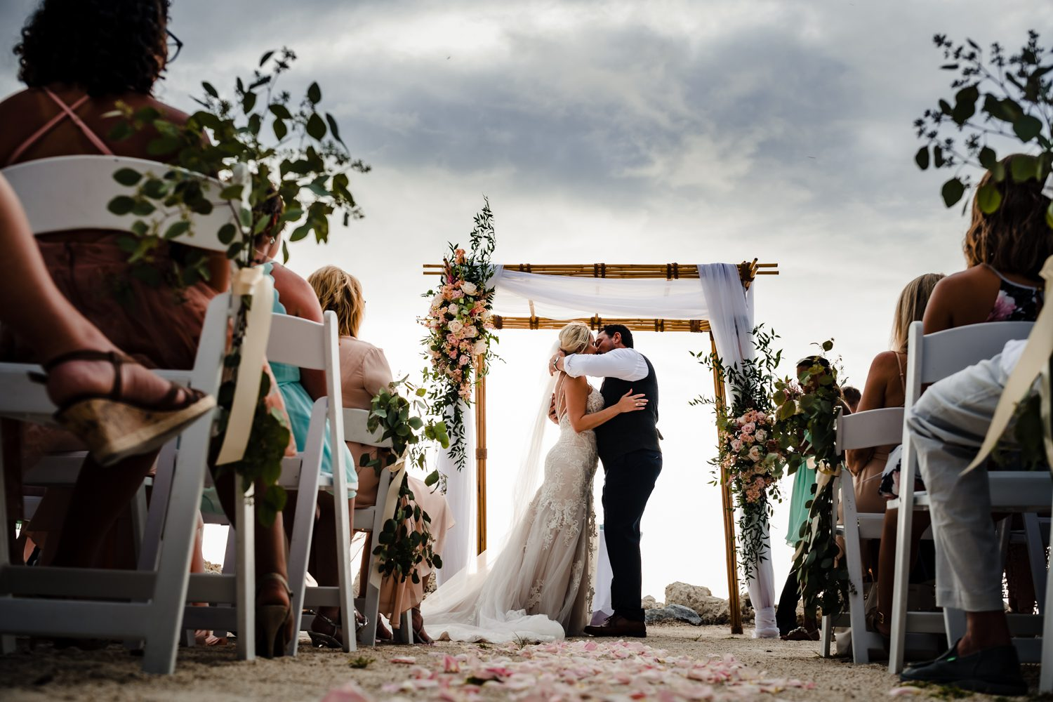Bride and groom kissing after wedding vows at fort zachary taylor