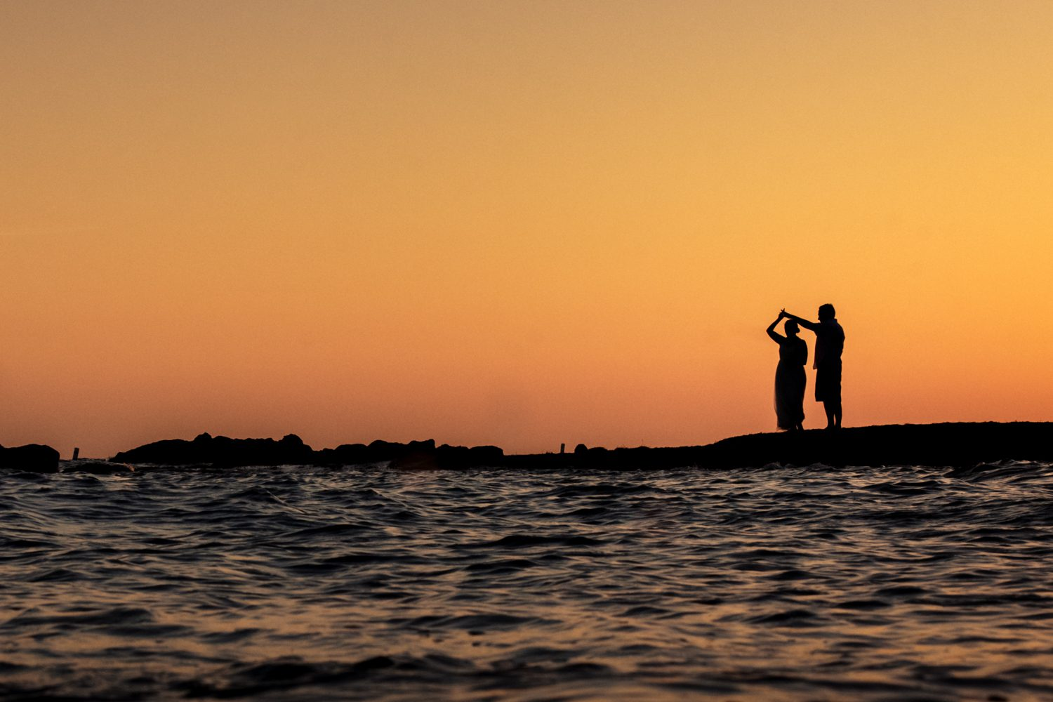 Man and woman silhouetted on the beach at at fort zachary taylor