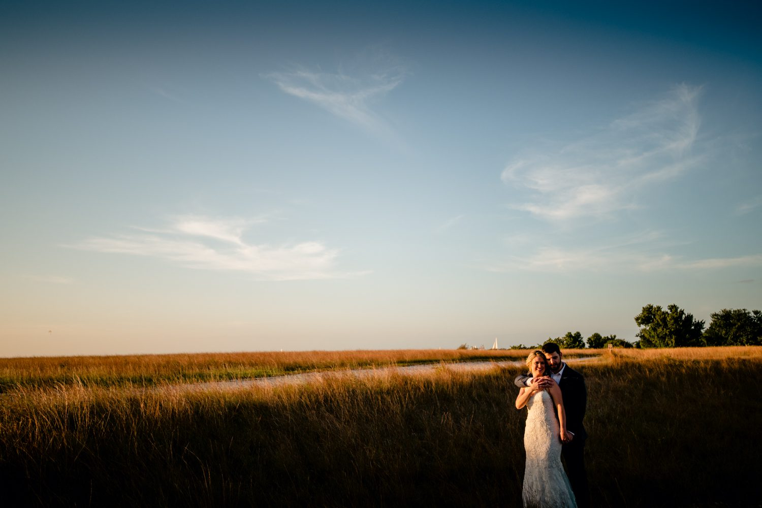 Newlyweds looking at the sunset at fort zachary taylor