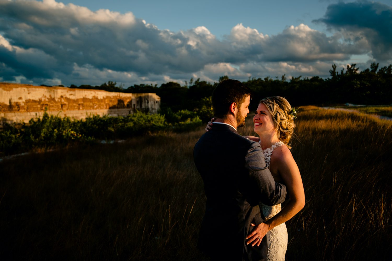 Newlyweds on the beach at fort zachary taylor