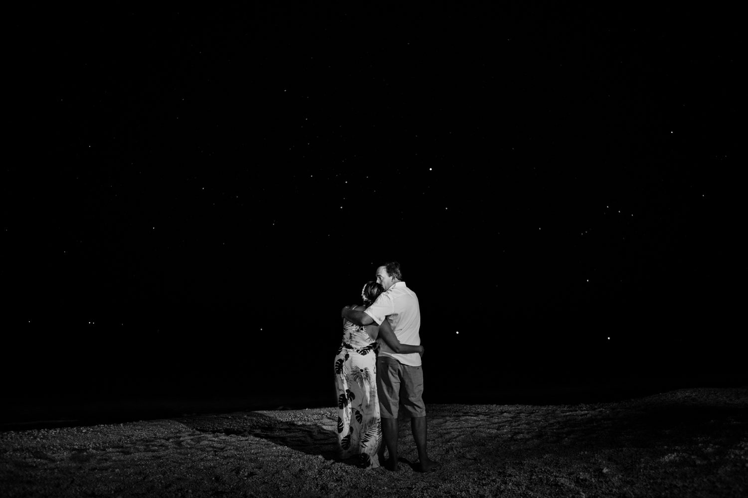 Man and woman on the beach at fort zachary taylor for a wedding