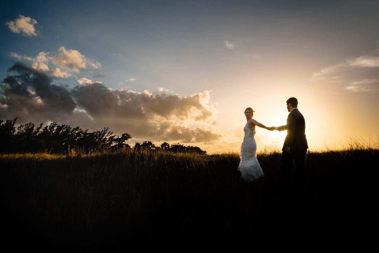Newlyweds on the beach at at fort zachary taylor