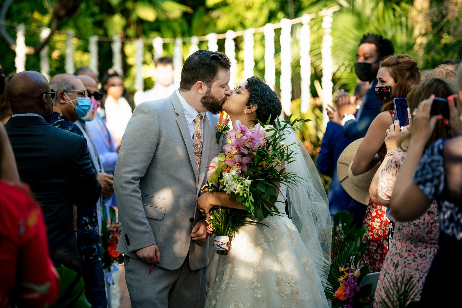 Bride and groom kissing during a wedding ceremony