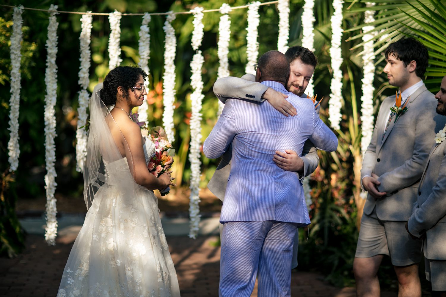 Groom hugging his brides father after wedding ceremony