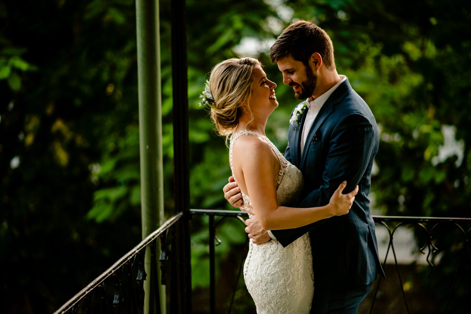 Bride and groom embracing for a portrait at hemingway house
