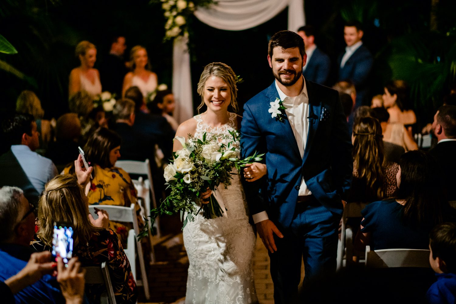 Bride and groom walking down the aisle after wedding ceremony at hemingway house