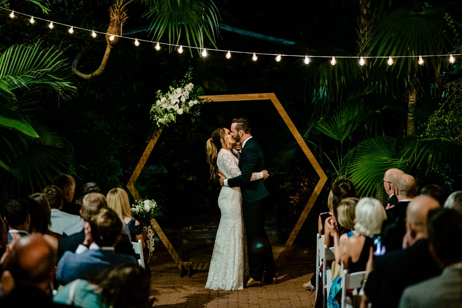 Bride and groom kissing as they say their vows