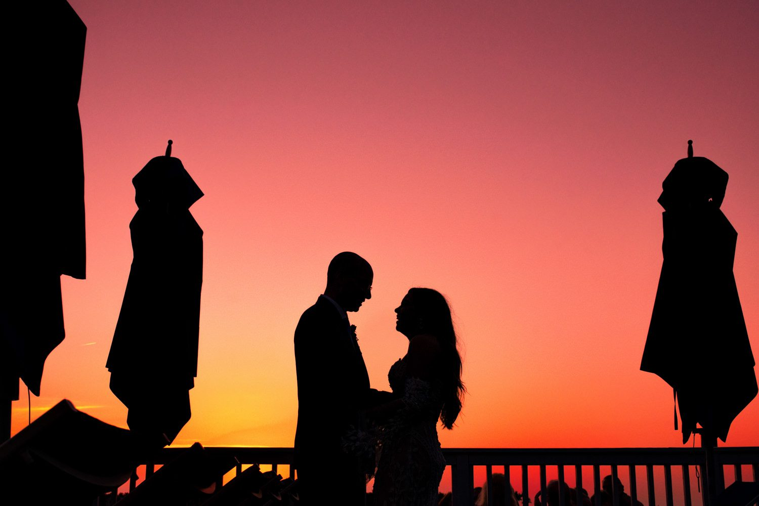 Silhouette of married couple at sunset in Key West
