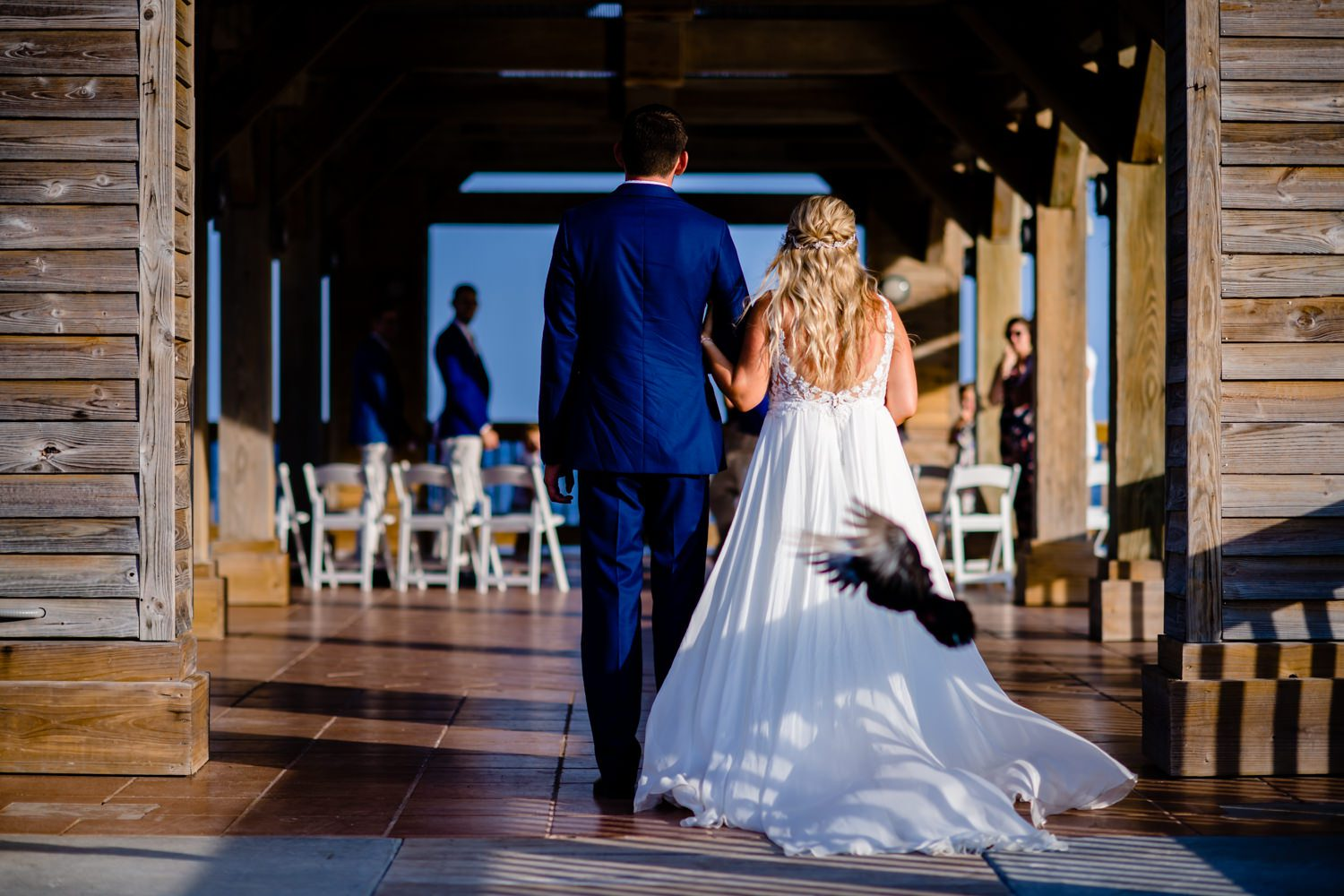Bride and Groom walking down the aisle with blue sky in the background in the Florida Keys
