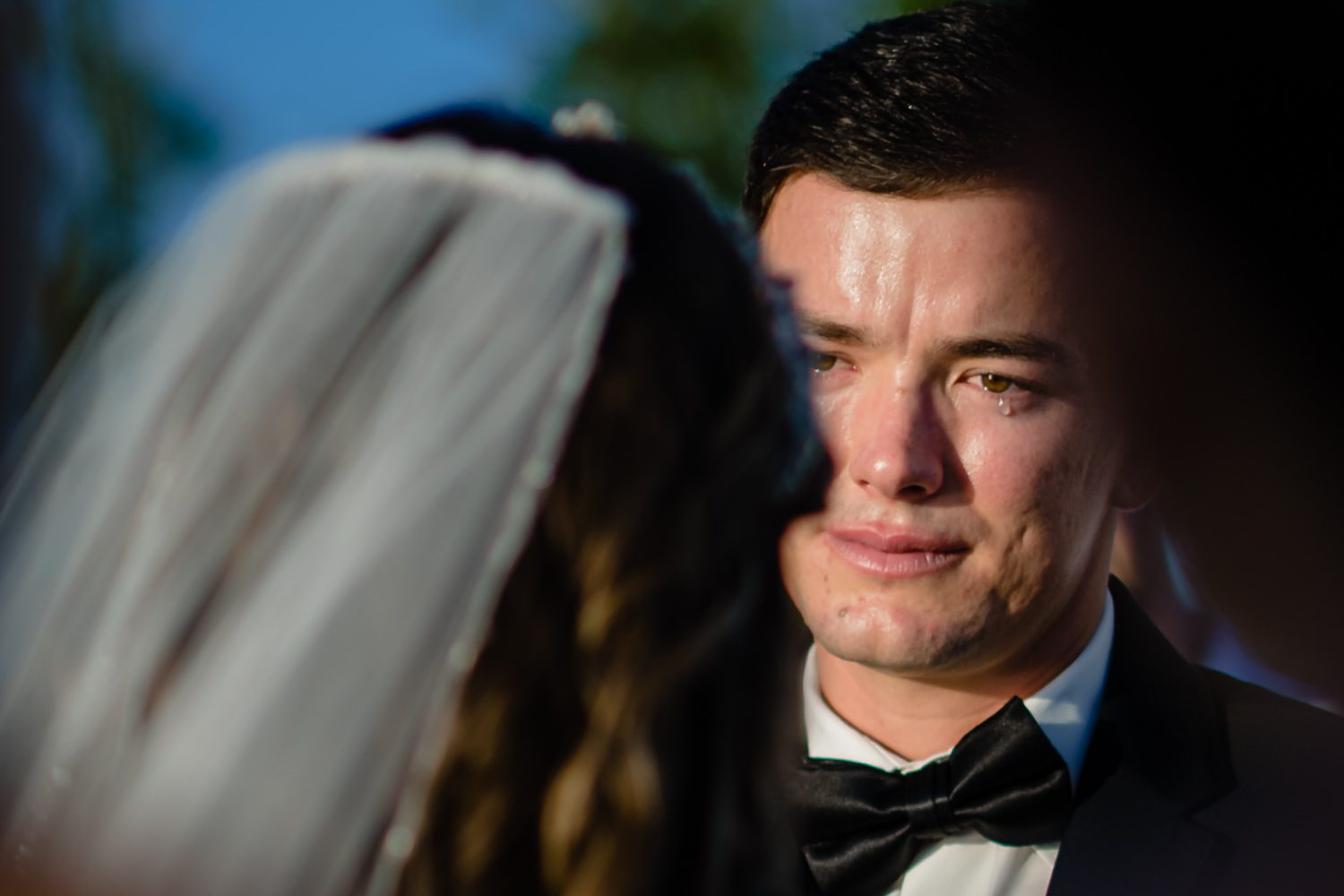 Groom crying as he looks at his bride before getting married in key west.