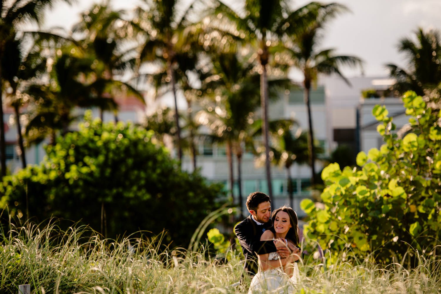Bride and groom taking a portrait before their miami wedding