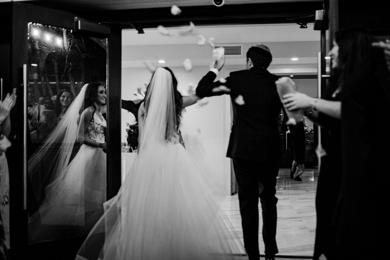 Bride and groom entering their wedding reception in miami