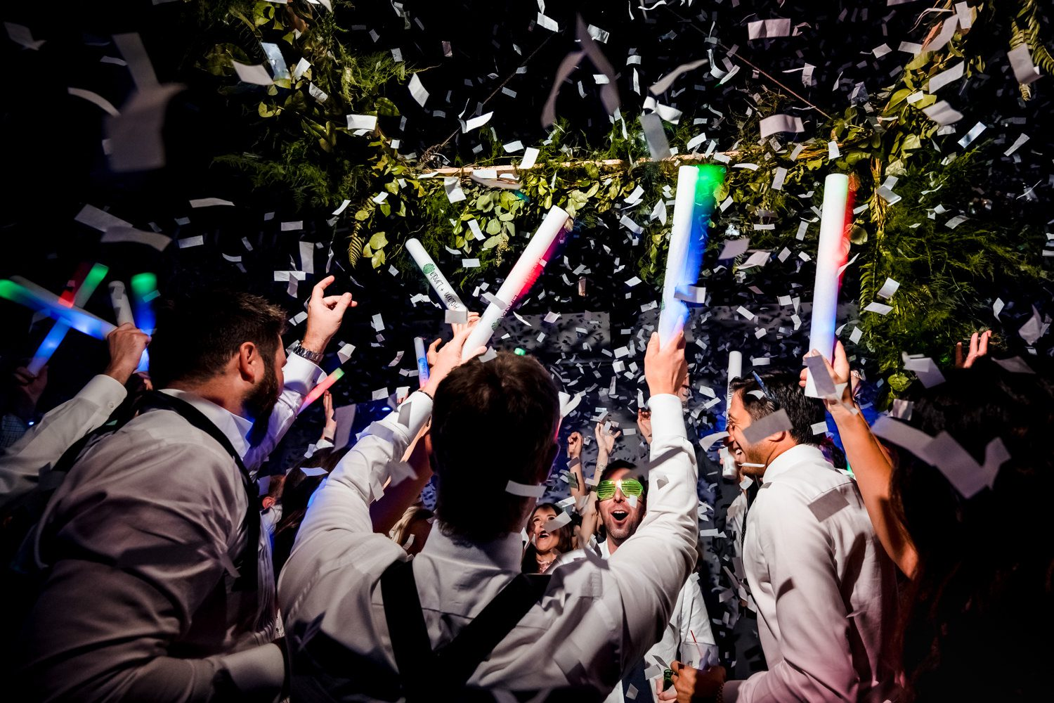 People throwing confetti after a wedding in miami