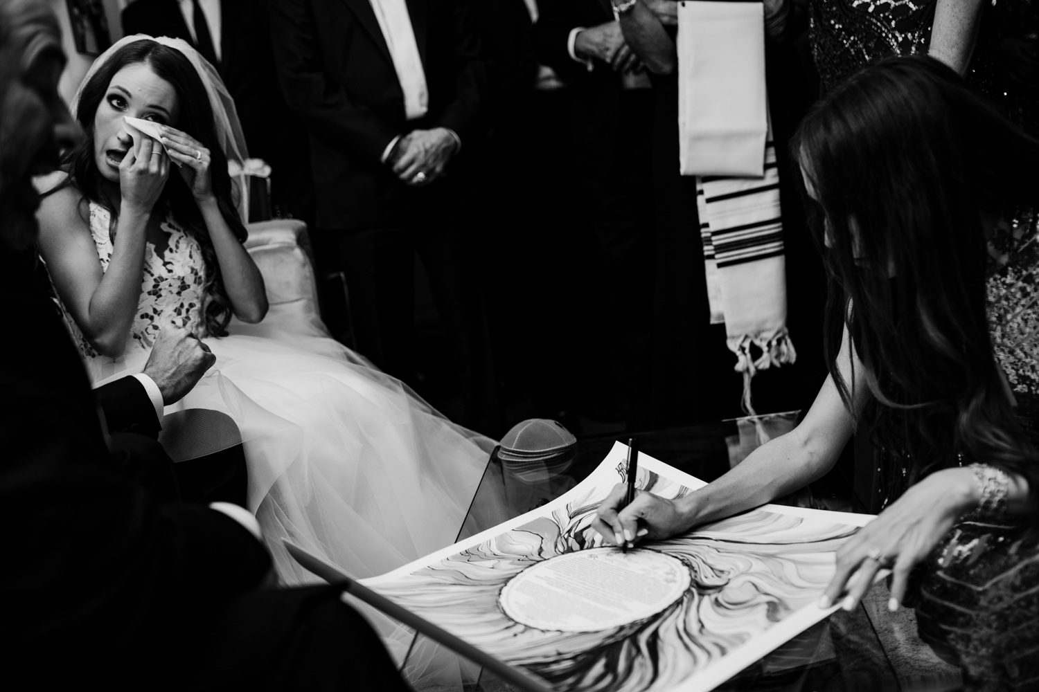 Guests signing a wedding book at a miami wedding reception