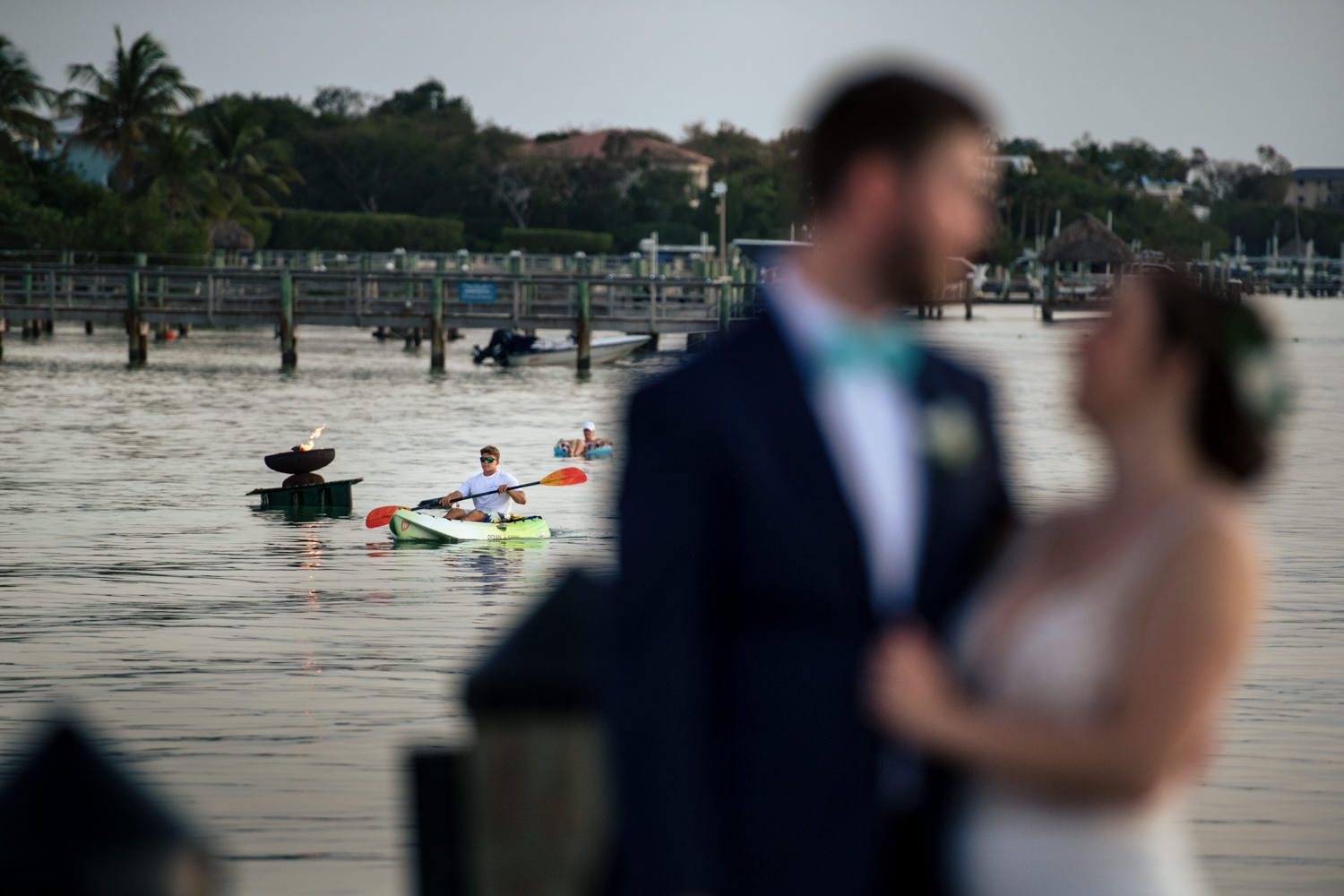 Newlywed couple standing on a pier in playa largo