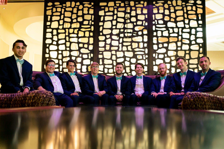 Groomsmen sitting around a table