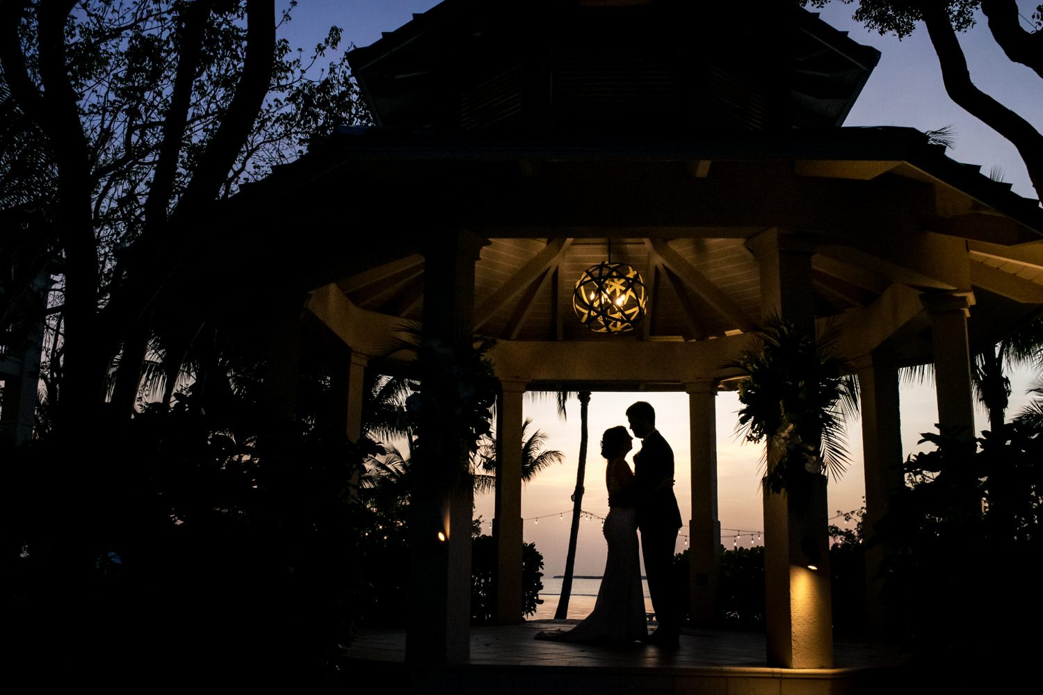 Silhouette of a couple embracing after their wedding ceremony