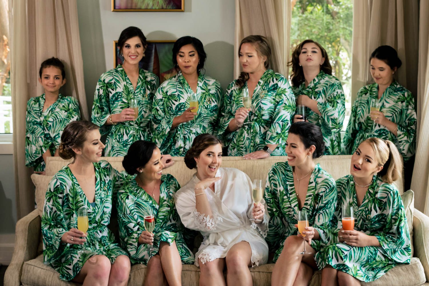Bridesmaids sitting and smiling