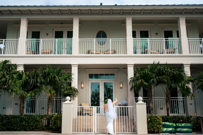 Bride standing in front of hotel in playa largo