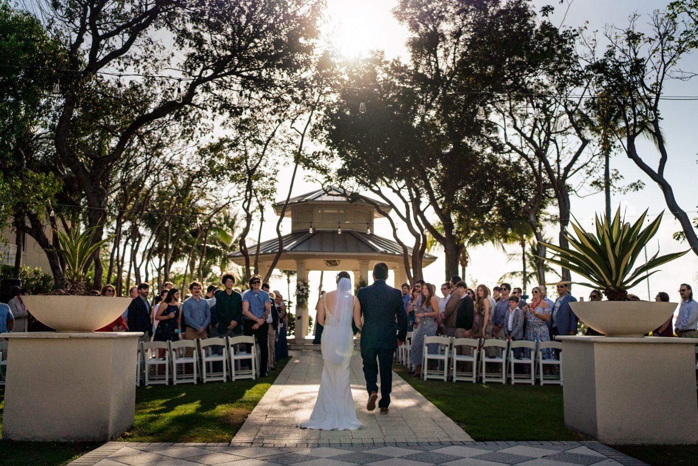 Bride and groom walking down the aisle in playa largo
