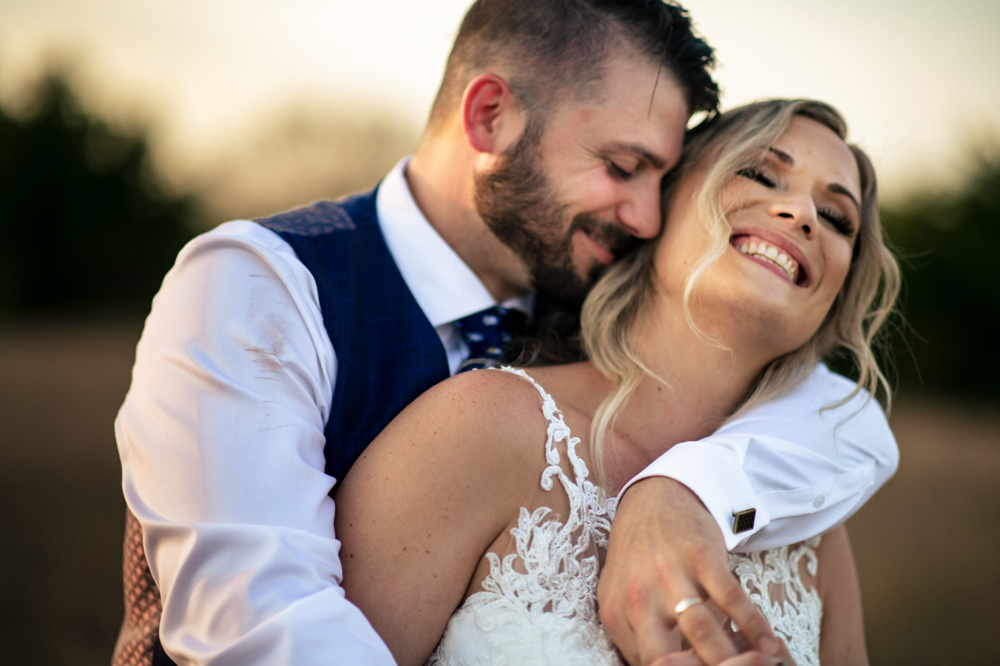 bride and groom in an intimate hug