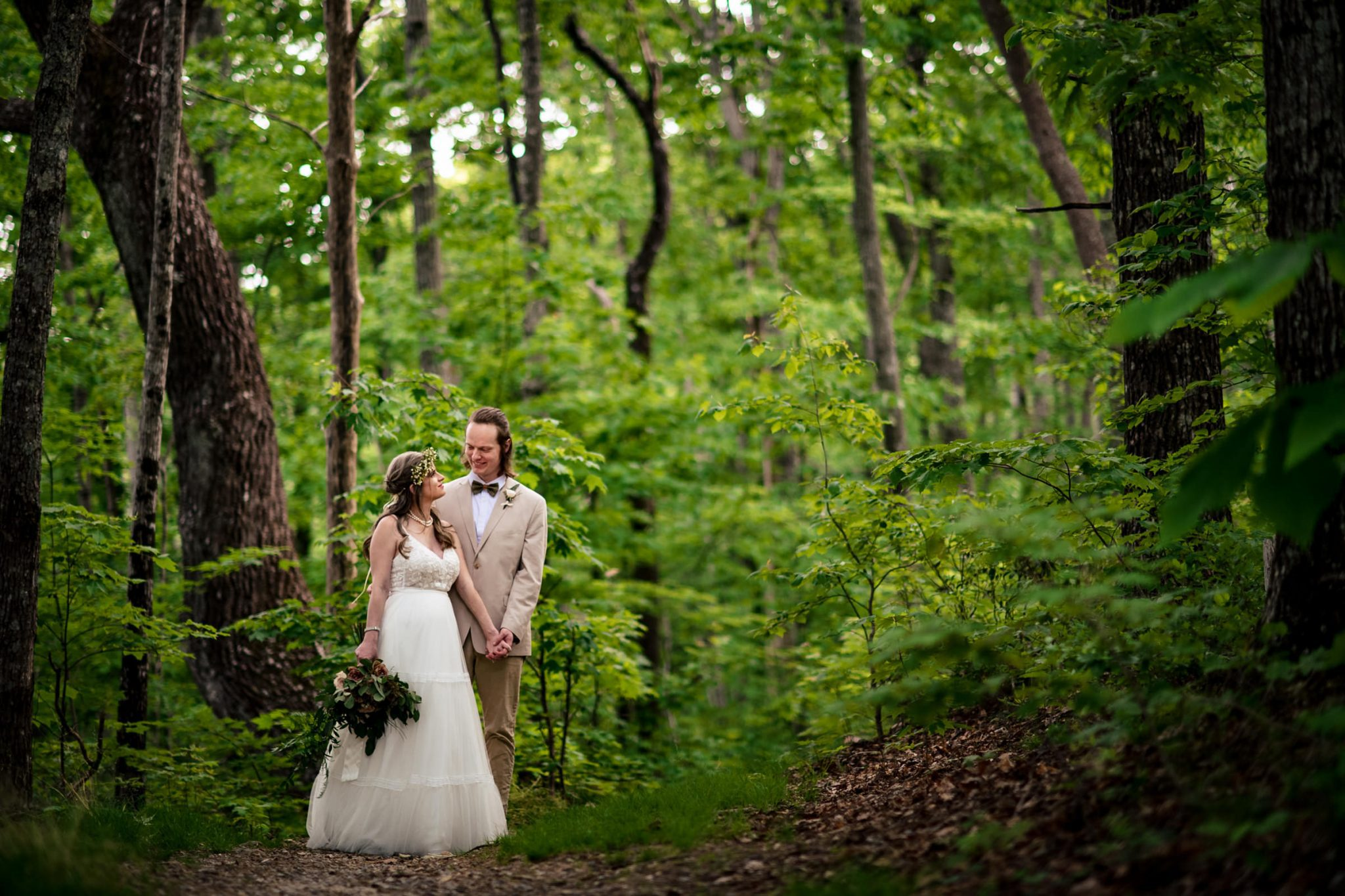 bride and groom in a wooded forest