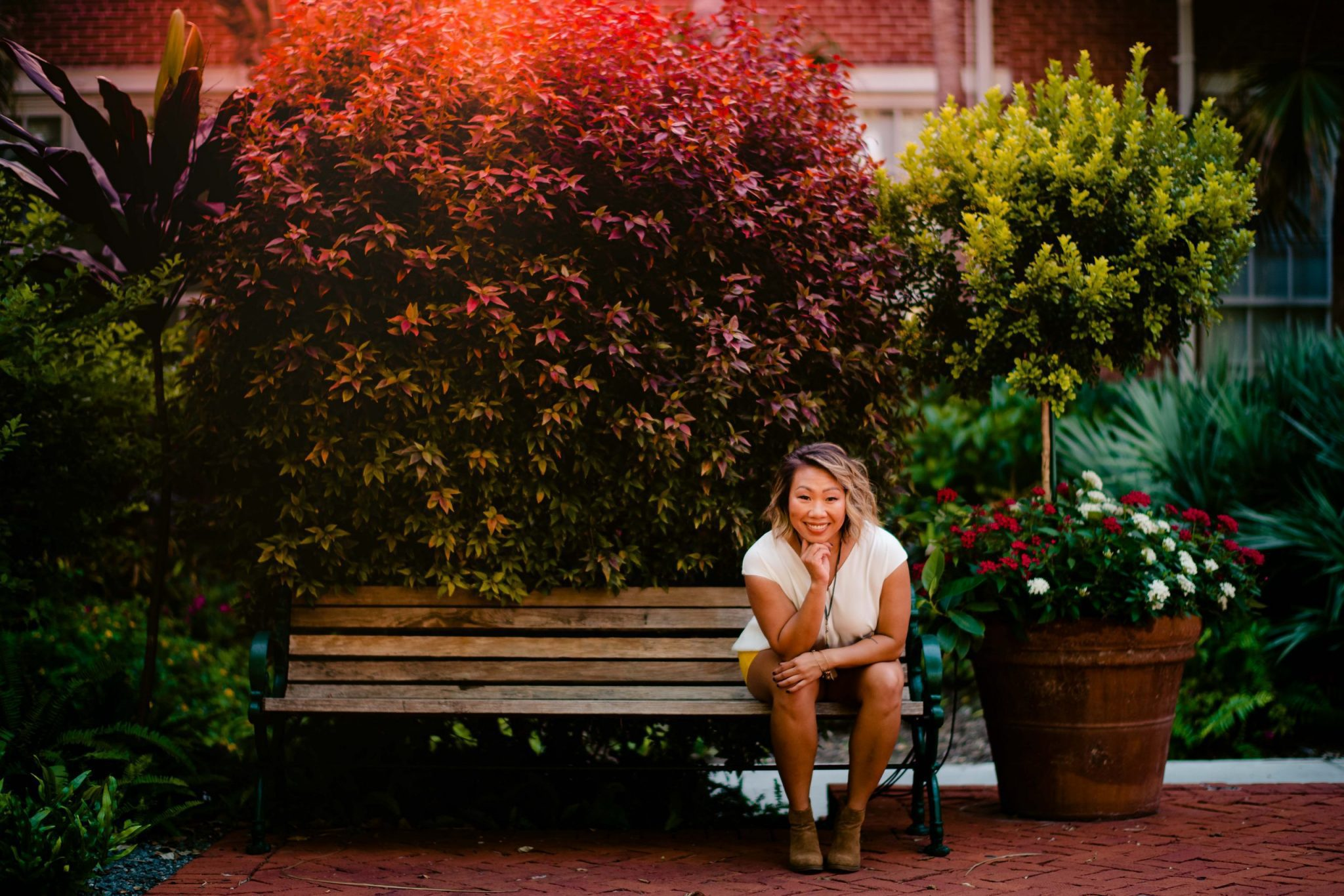 woman sitting on a bench for a personal branding photoshoot in the florida keys