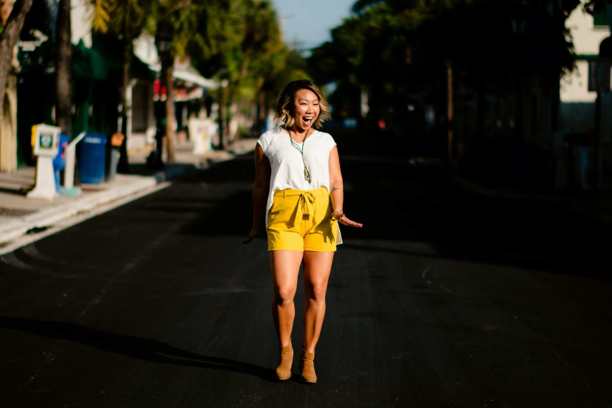woman walking down the street for a personal branding photoshoot in the florida keys