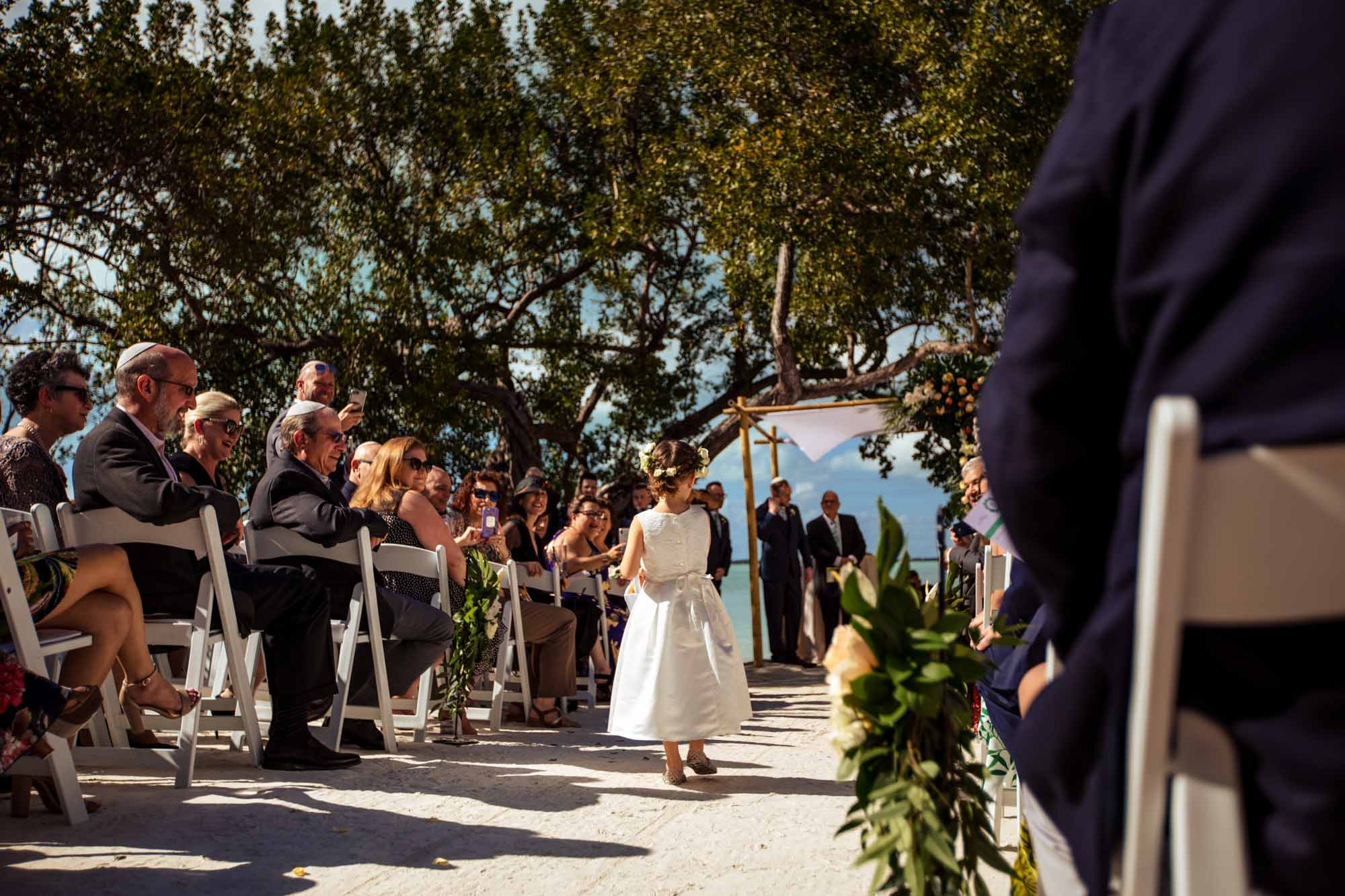 Bride walking down the aisle on the beach at bakers cay