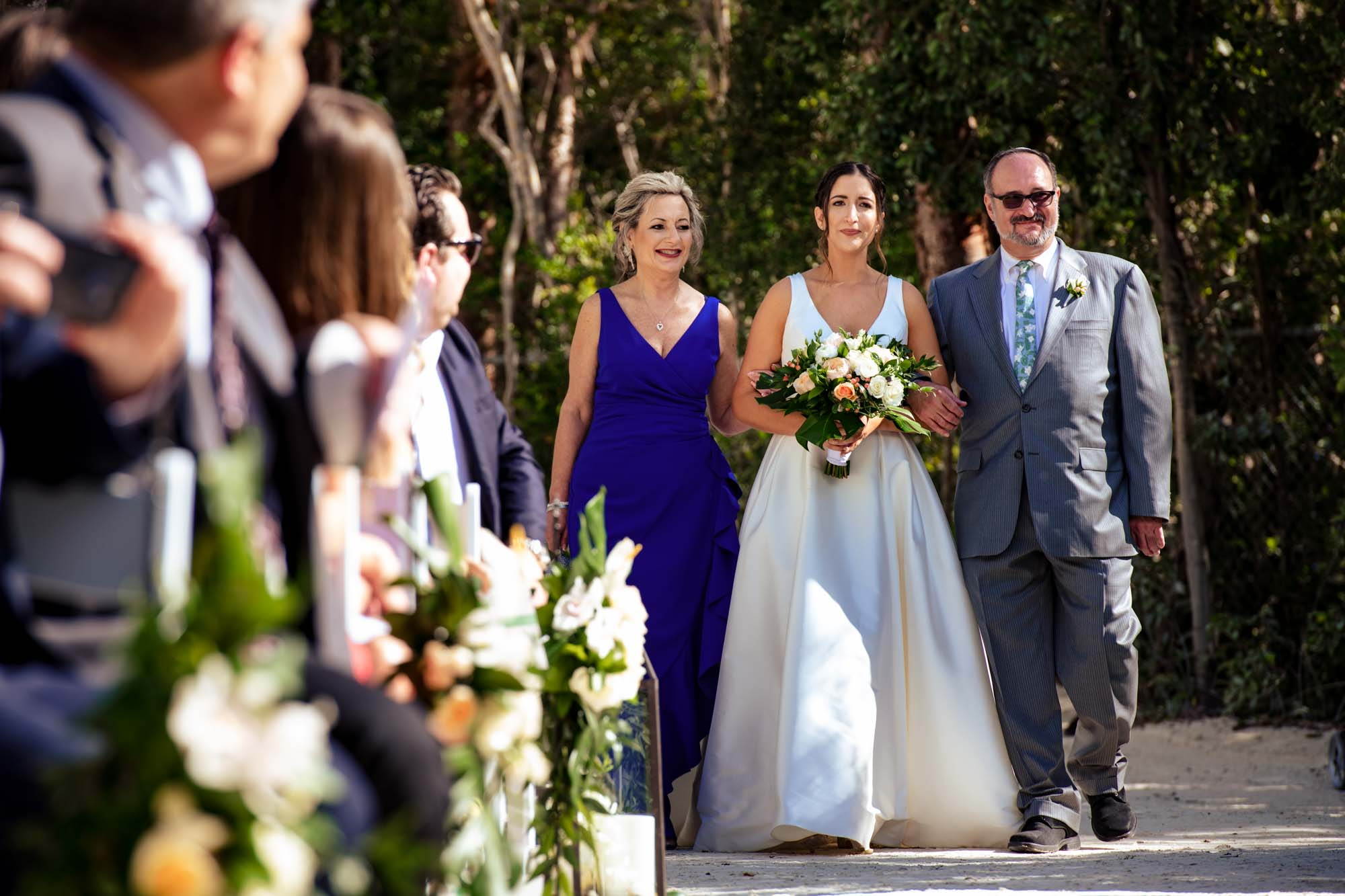 Bride walking down the aisle with her father at bakers cay