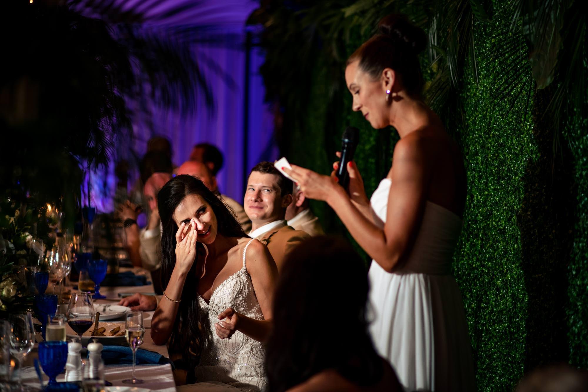 Bridesmaid giving a speech at wedding reception
