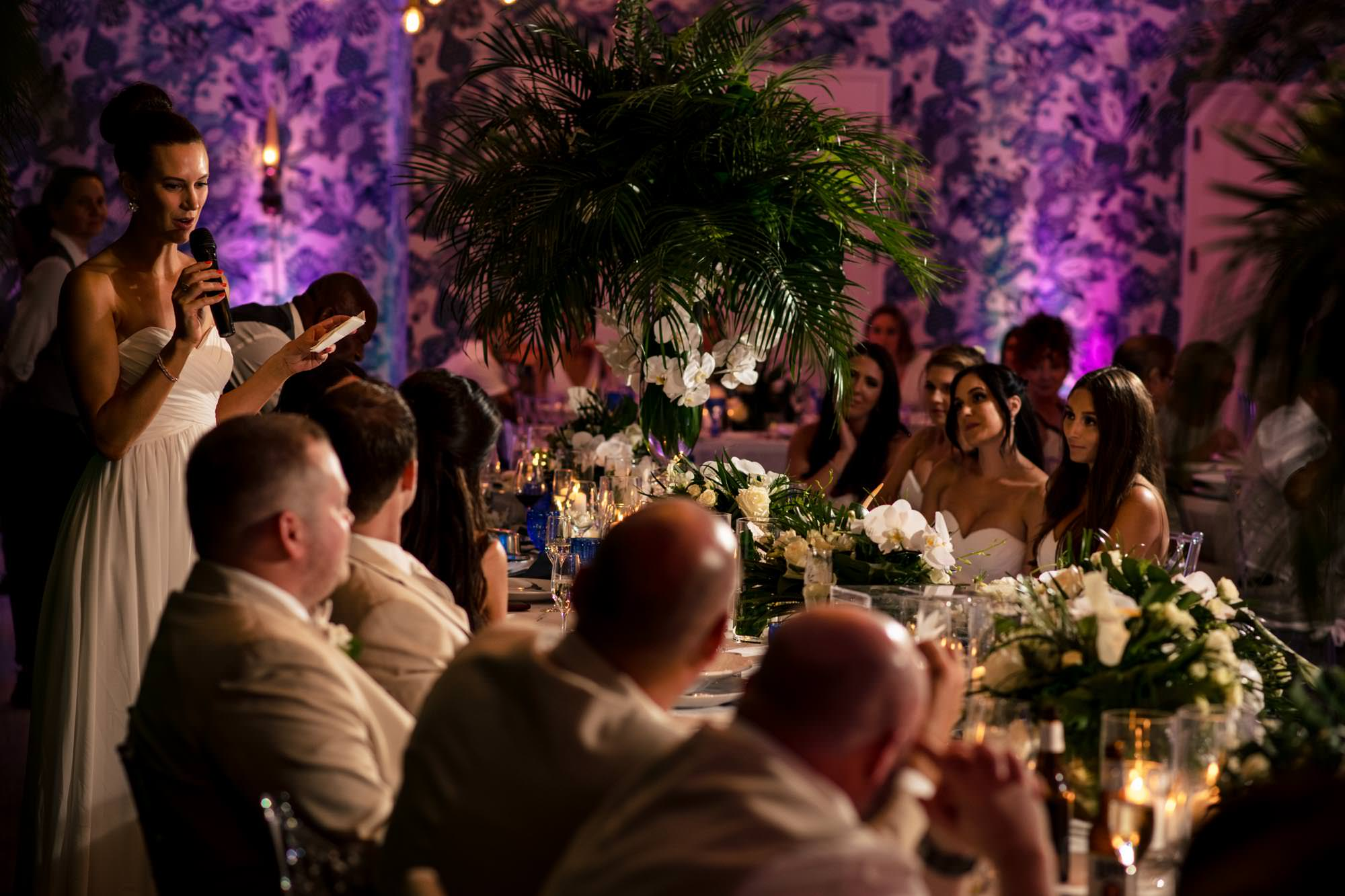 Group of people looking at the bride and groom at a wedding reception