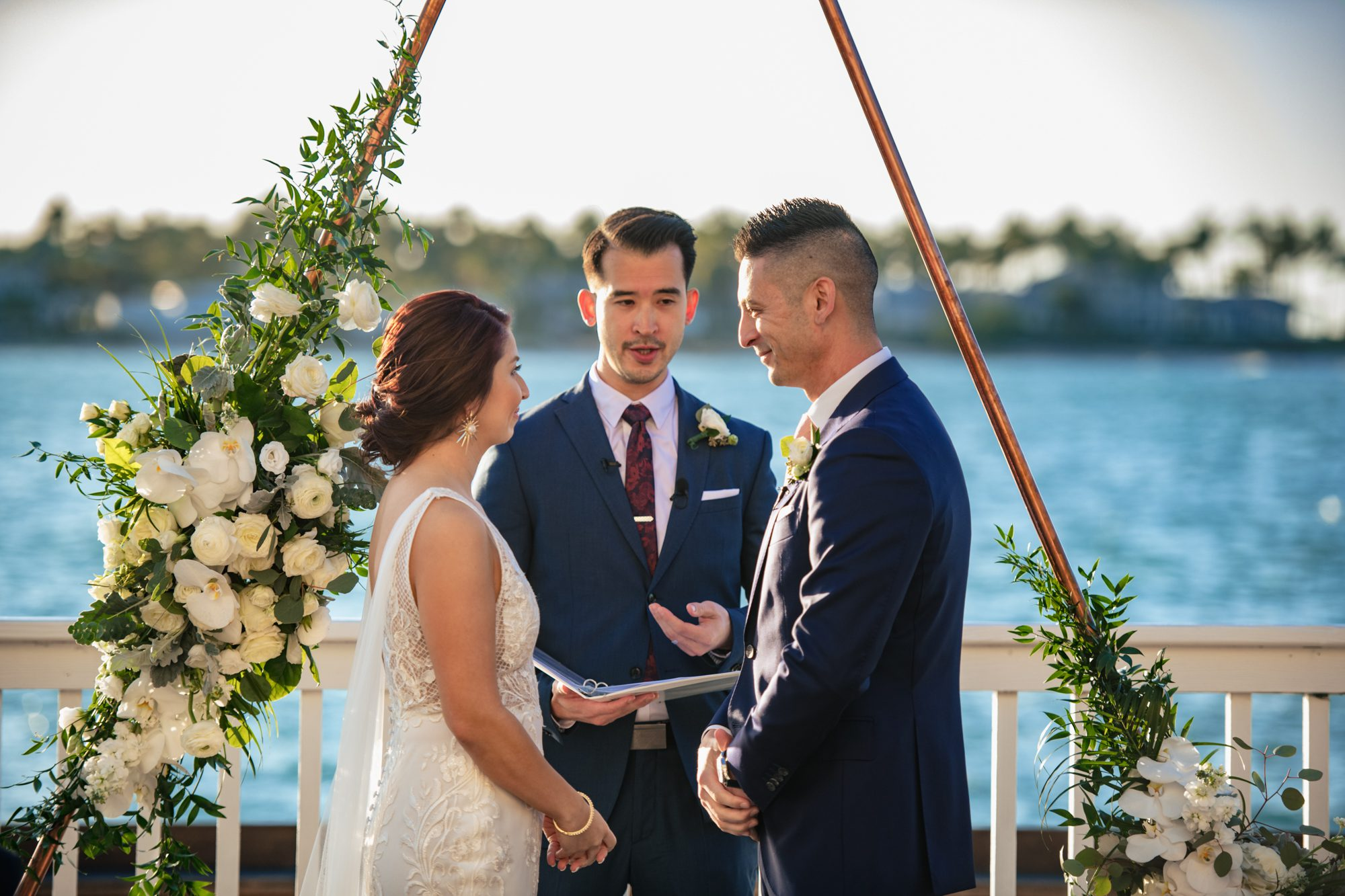 bride and groom during a waterfront ceremony