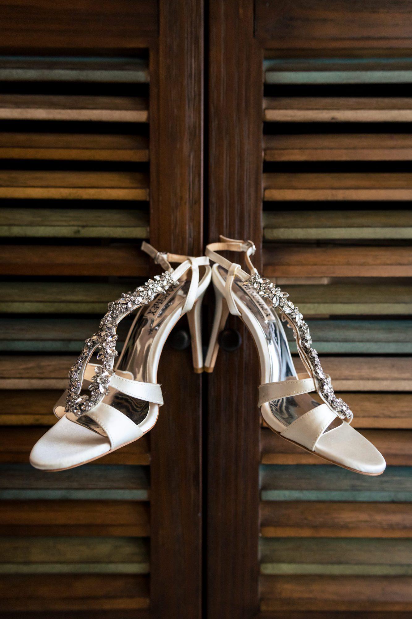 brides shoes hanging on closet