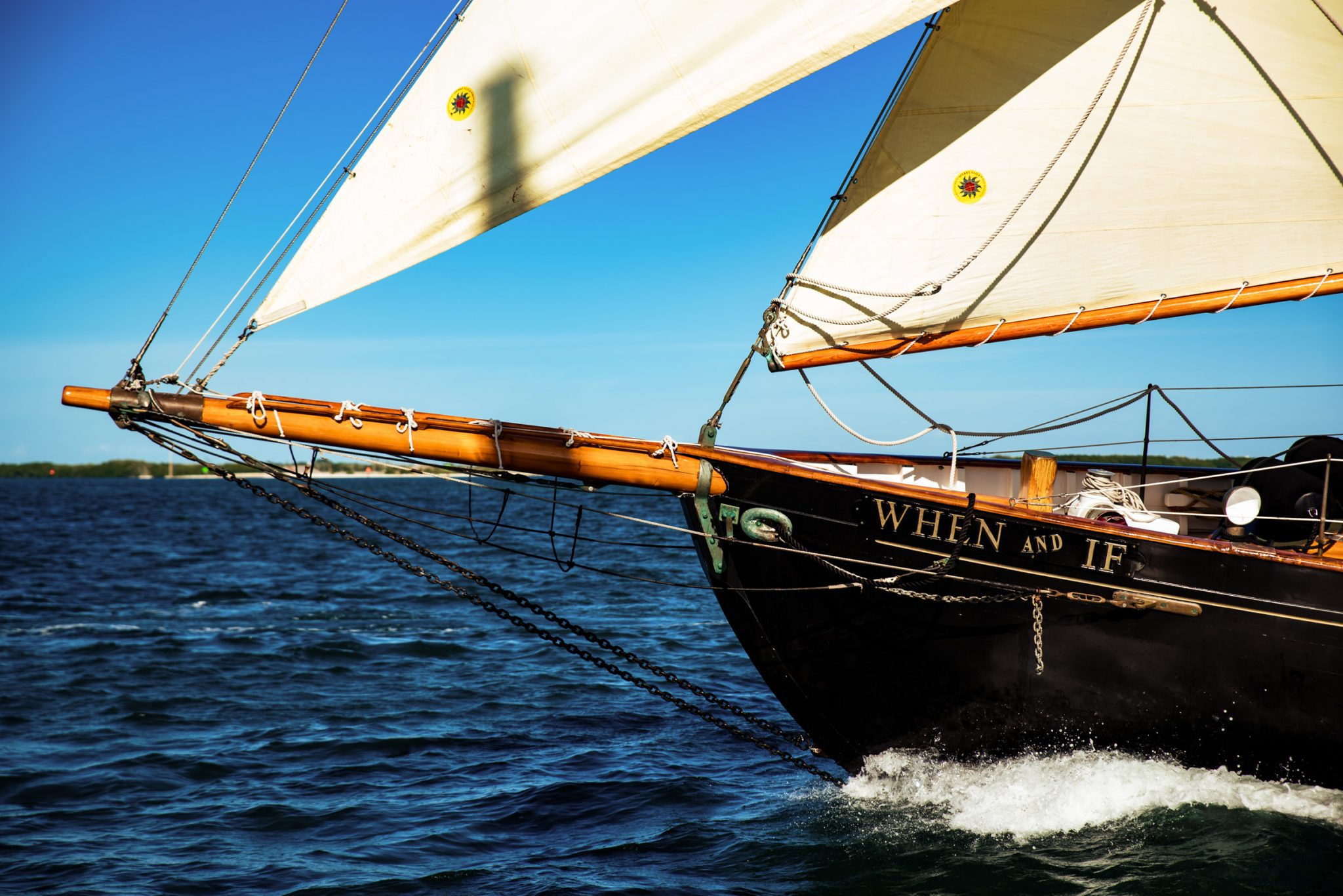 Bow of a sailboat as it sails in the ocean for commercial photography