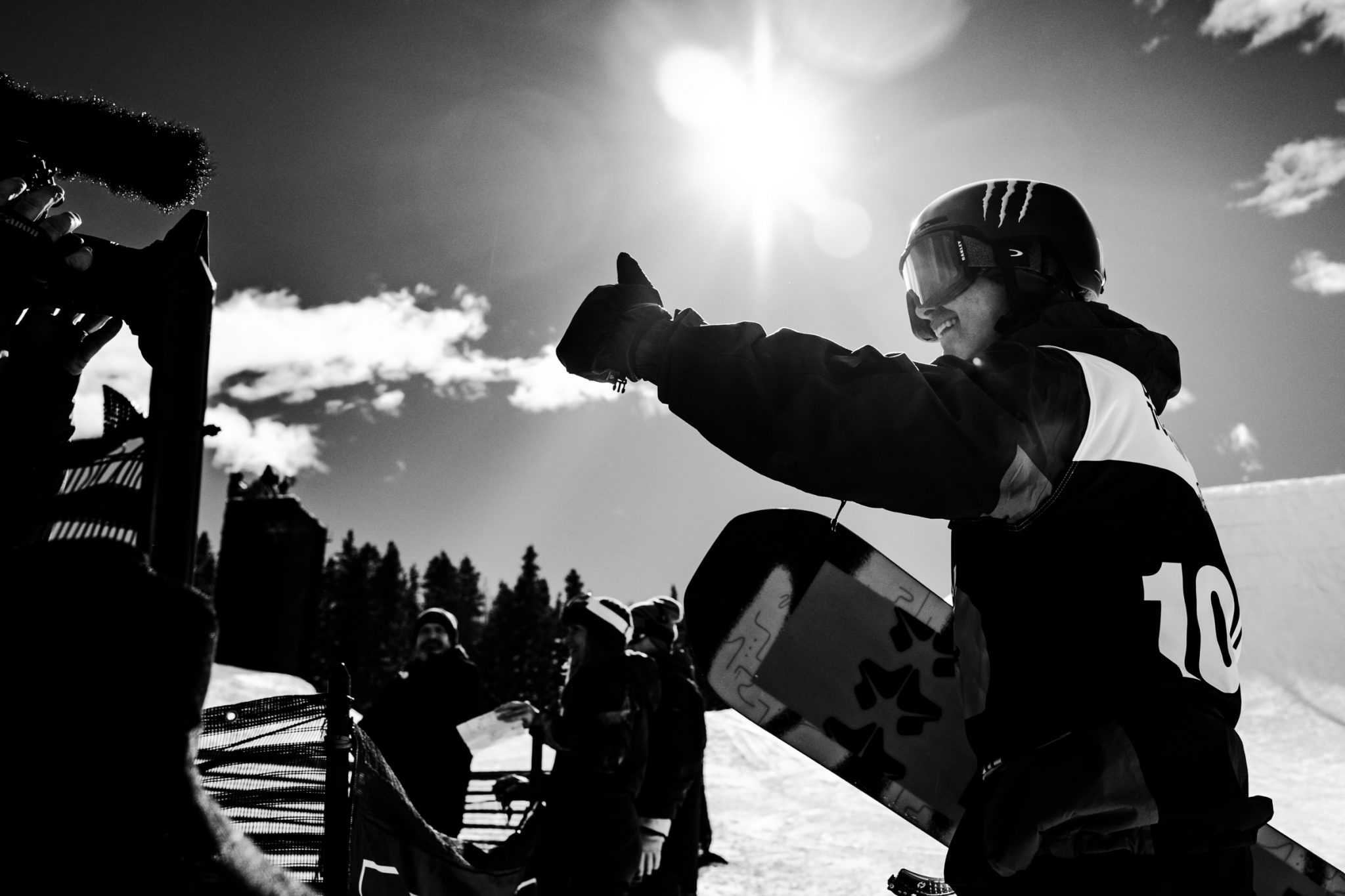Competitive snowboarder giving thumbs up