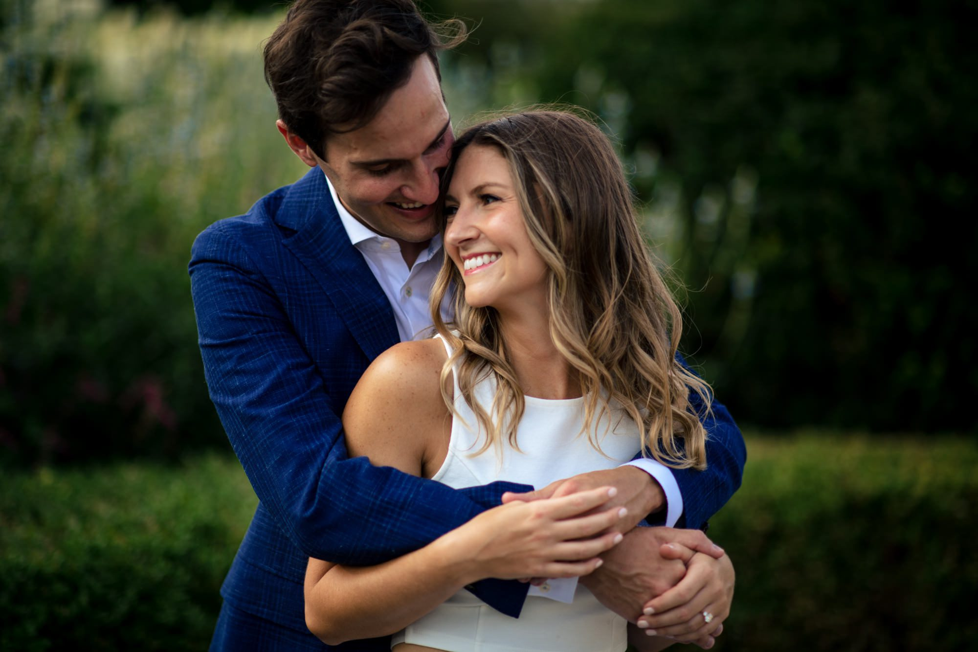 couple hugging and flirting in rose garden chicago engagement photos