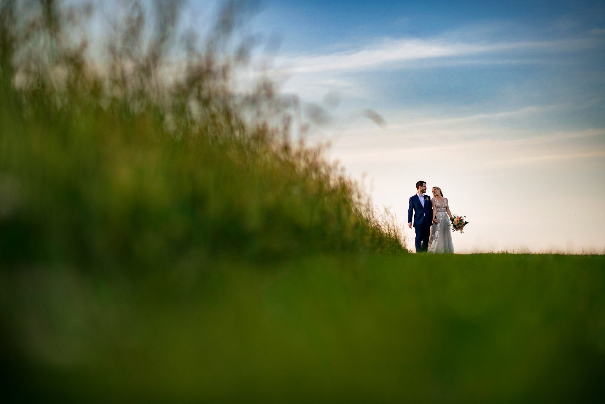creative sunset photo of bride and groom at the farm asheville wedding photographer