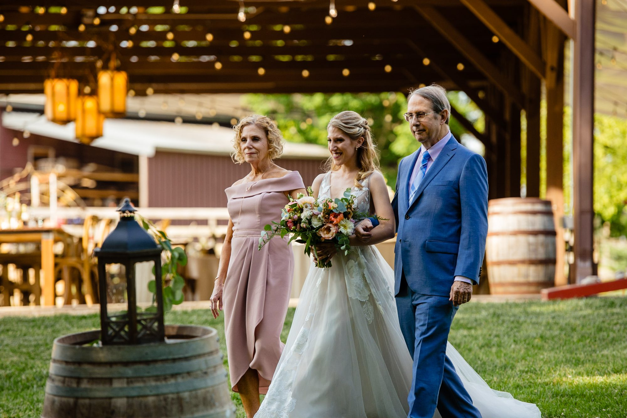mother and father walking bride at asheville wedding